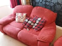 Red two seat sofa and matching armchair offered free