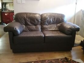 2seater chocolate brown leather sofa.