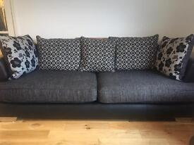 Modern 3 seater cushion back couch with matching revolving snuggle chair