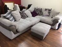 Corner sofa with footstool