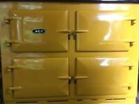 An Aga front in yellow. It was replaced after a slight chip on the bottom corner. Perfectly useable.