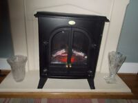 A BLACK DIMPLEX ELECTRIC LOG FLAME EFFECT STOVE