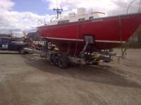 A  / ONE  BOAT HAULING ON HYDRAULIC TRAILER GREAT PRICES