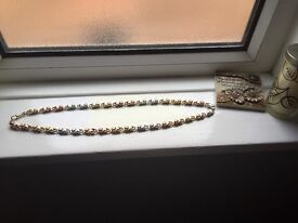 125 gram 9ct solid gold multi necklace. Rose gold, yellow gold and white gold screwlink design.