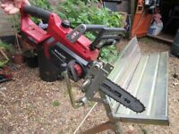 metal saw bench with chainsaw holder for logs