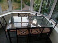 IKEA Granas Table and Chairs, glass top, black metal frame, six dining chairs