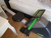 Elevation rower machine