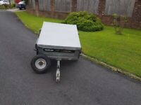 Daxara 107 trailer. Comes with cover and spare wheel. Tipping mechanism and tail gate drops down.