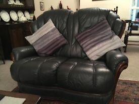 Dark grey leather settees