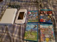 Nintendo Wii U 8GB console + 5 games. Excellent condition