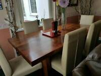 Stunning indian style chunky solid wood dining table with leather chairs