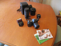 Canon T70 35mm camera,lenses and flash.