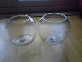 Two glass fish bowl vases, plants or wedding decoration