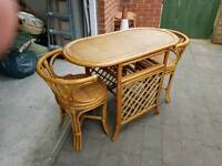 Conservatory wicker table and chairs