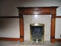 Cream marble hearth and fire back