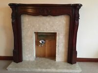 Fire surround and hearth. Mahogany colour fire surround with marble hearth.