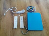 Nintendo wii console with 2 remotes, nunchuck and lego batman 2