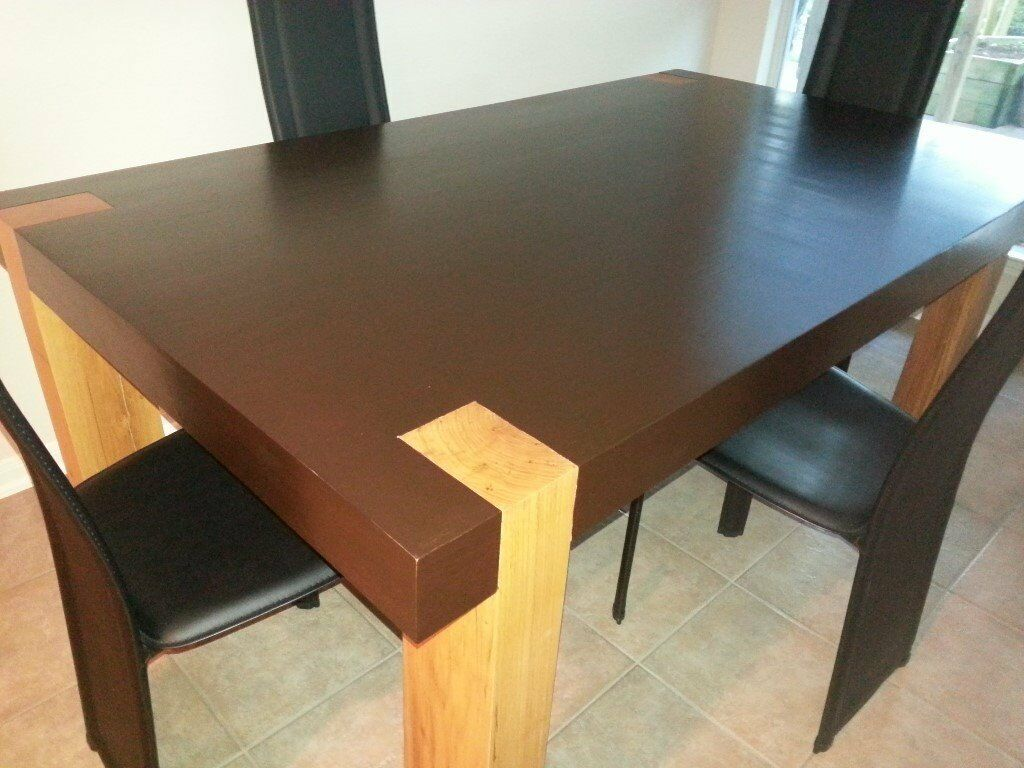 Custom made dining table solid white oak asymetrical legs and stained red oak top