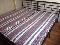 2 metal frame beds, mattresses available if wanted.