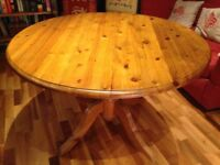 Drop leaf circular pine dining table 121cm diameter x 78cm high - legs can be take off for transport