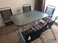 Gardenset 6 chairs glass table, good condition