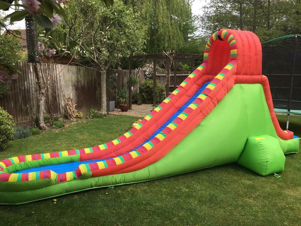 AIRFLOW INFLATABLE WATER SLIDE WITH BLOWER, HOSE, STAKES AND REPAIR KIT  |  in Storrington, West Sussex | Gumtree