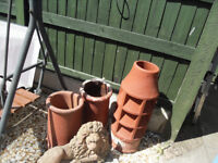 3 Chimney pots and stone lion