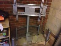 Glass tv stand with support bracket