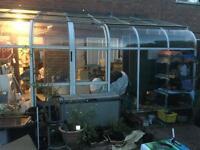Green house/sunroom lean to. Aluminium glass.