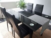Glass dining table plus four chairs
