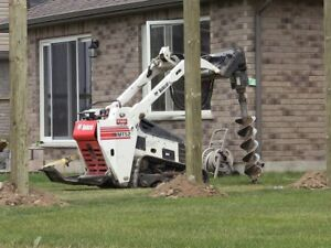 Bobcat with auger attachment and trailer for good price