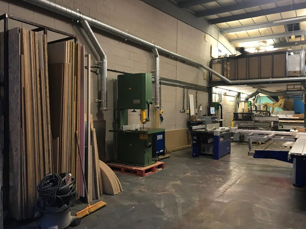 wood workshop bench space for rent in shared unit. well
