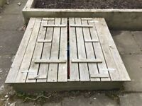 Sandpit with bench and lid