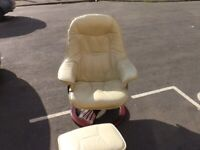 cream leather swival chair and foot stool
