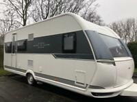 6 berth fixed bed & fixed bunks Hobby excellent 560. Immaculate condition like new with motor mover