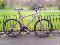 "Trek 3500 bike, 18"" frame, 24 speeds, disc brakes, includes lights."