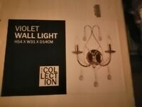 Wall light brand new in box unopened