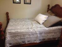 Sold***. Queen size wooden bed