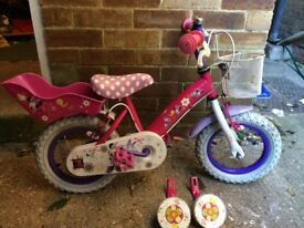 Pink Disney child's bike with stabalisers
