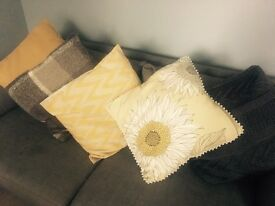 Grey and yellow cushions