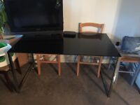 Large black glass dining table