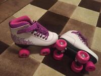 Girls roller skates and helmet