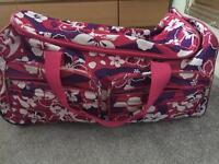 Pink and purple holdall