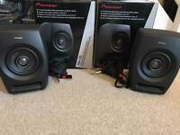 Pair of pioneer RM-05 studio monitors and cables.