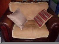 a sofa with its cushions
