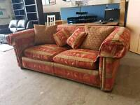 Red fabric patterned two seater sofa