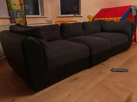 3-4 seater 1/2 leather and 1/2 cloth sofa excellent condition