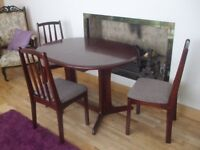 Dining table and three chairs for sale.