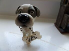 small resin dog