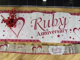 Ruby Wedding banner and table decorations.